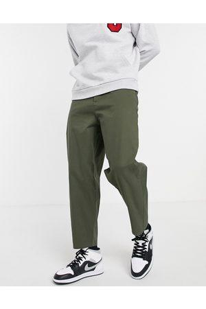 ASOS Oversized tapered chinos in khaki-Green