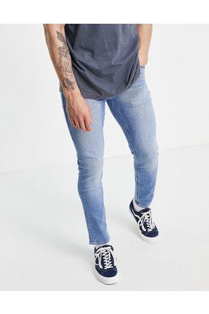 ASOS Stretch slim jeans in vintage light wash-Blue