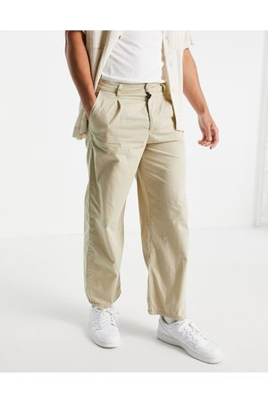 ASOS Lightweight wide leg trousers with pleats in -Neutral