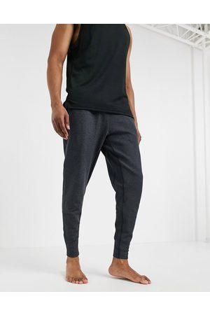 Nike Nike Yoga Dri-FIT joggers in dark grey marl