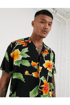 ASOS Relaxed fit revere shirt in large scale black and yellow floral