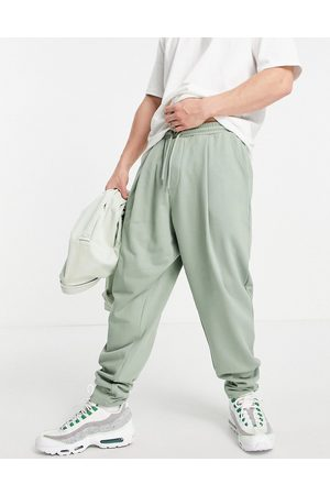 ASOS Organic co-ord oversized wide leg joggers with pressed pleat in green