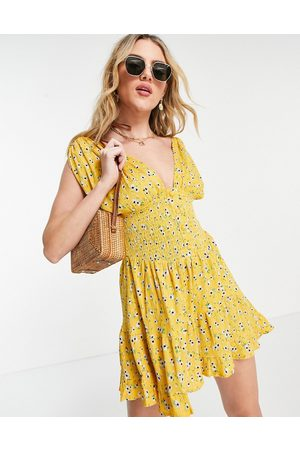 ASOS Shirred waist button front tiered mini sundress in yellow floral print-Multi