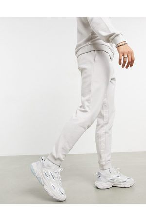 ASOS Co-ord tapered joggers with Roman numerals inside taping in dusty grey