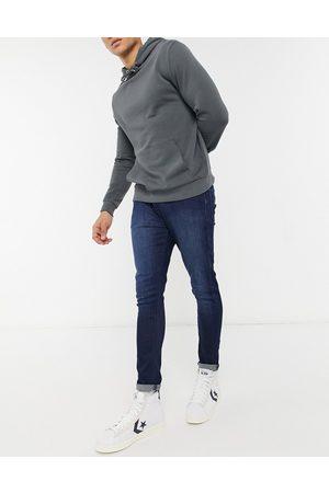 ASOS Super skinny ankle grazer jean in dark wash-Blue