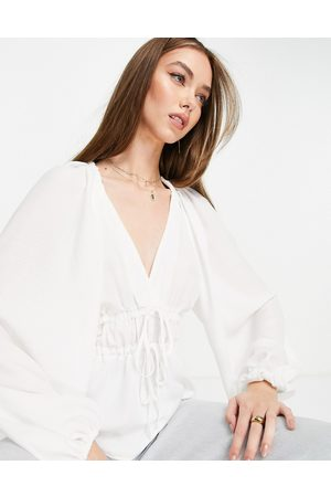 ASOS Long sleeve v neck top with kimono sleeve and tie front in ivory-White