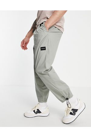 ASOS ASOS Unrvlld Spply lightweight oversized tapered joggers in grey