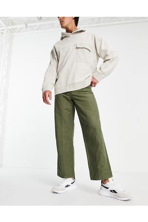 ASOS Wide fit trousers in heavy wash in khaki-Green
