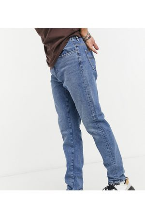 COLLUSION X003 tapered jean in mid wash blue