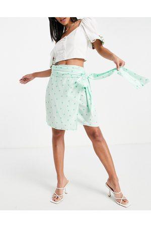 Style Cheat Mini wrap skirt co-ord in green heart print