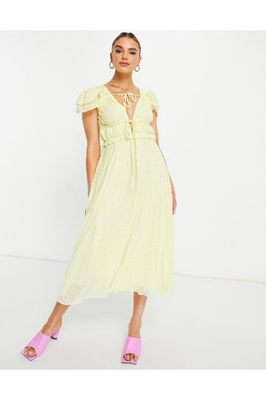 ASOS Plunge pleated midi dress in broderie dobby in yellow