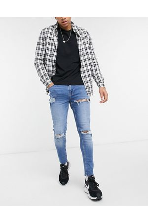 ASOS Skinny jeans in mid wash blue with heavy rips