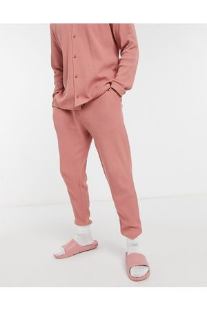 ASOS Tapered joggers with fixed hem in pink waffle