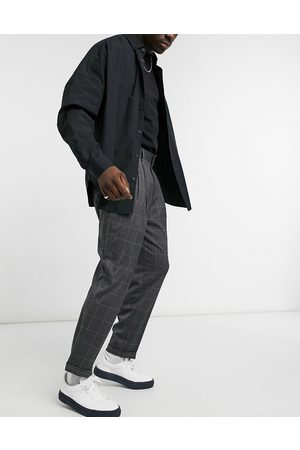 ASOS Oversized tapered smart trousers in check-Grey