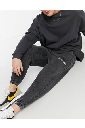 ASOS Co-ord oversized joggers with multi-placement logo in black acid wash