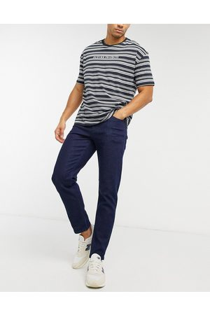 ASOS Tapered jeans in indigo-Blue
