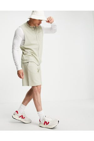 ASOS Co-ord waffle relaxed fit shorts with cargo pockets in dusty khaki-Green