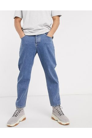ASOS Relaxed tapered jeans in mid wash blue
