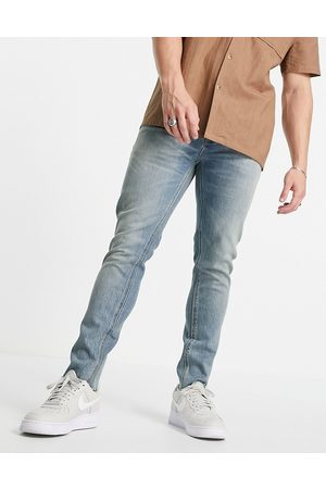 ASOS Cone Mill Denim skinny fit 'American classic' jeans in vintage mid wash with raw hem-Blue