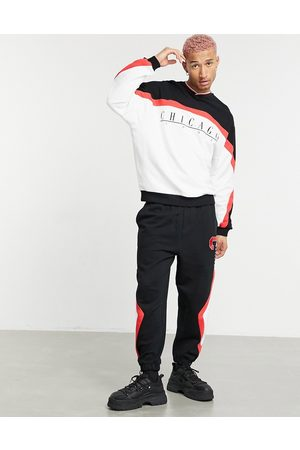 ASOS Co-ord oversized joggers with colour block Chicago print in vintage wash-Black