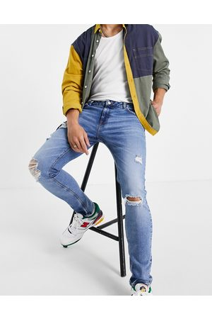 ASOS Skinny jeans in mid wash with heavy rips-Blue
