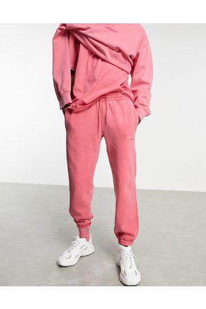 adidas Premium Sweats' overdyed joggers in hazy pink