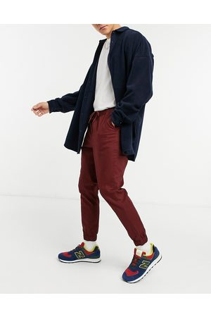 ASOS Tapered chino joggers in burgundy