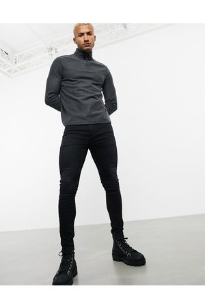 ASOS Spray on jeans in power stretch in washed black