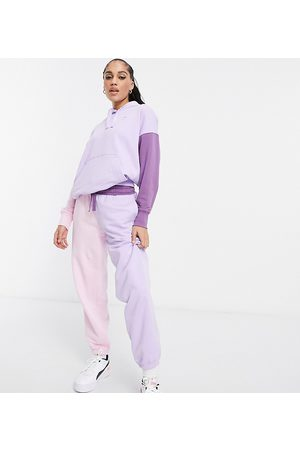 PUMA Downtown colourblock joggers in lilac and pink - exclusive to ASOS-Purple