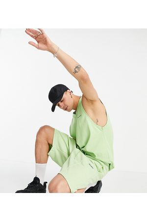 COLLUSION Herre Sett - Oversized poly tricot shorts in green co-ord