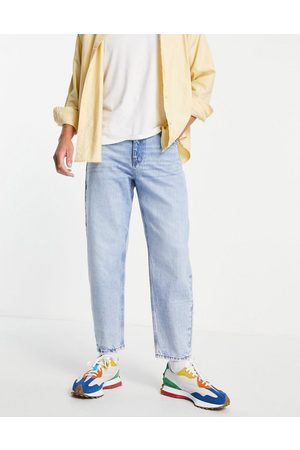 ASOS Relaxed tapered jeans in 'less thirsty' light wash-Blue