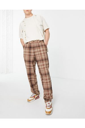 ASOS Baggy fit trousers in brown check