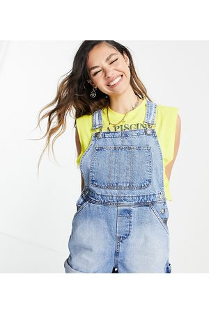 Reclaimed Inspired short dungaree in mid blue wash