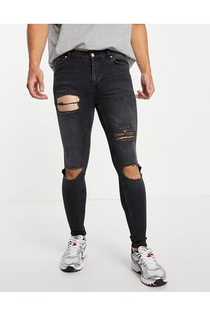 ASOS Spray on jeans with powerstretch in washed black wash with heavy rip