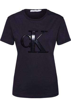 Calvin Klein Dame Kortermede - Skjorte 'FLOCK MONOGRAM CK SLIM TEE