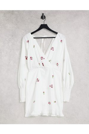 ASOS Cotton poplin wrap front mini dress with all over embroidery in white