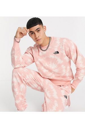 The North Face Oversized Essential joggers in pink tie dye Exclusive at ASOS