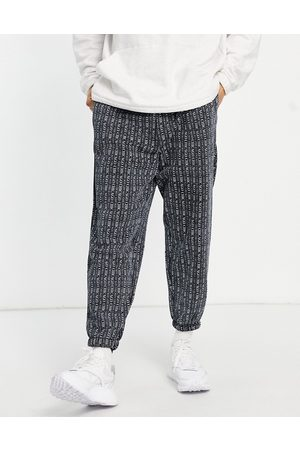 ASOS Oversized joggers in black with all over Chicago city print