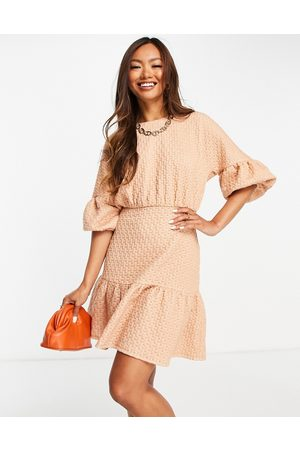 ASOS Puff ball open back tiered mini dress in pink & white texture