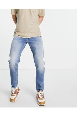 ASOS Herre Tapered - Stretch tapered jeans in vintage mid wash with rips-Blue