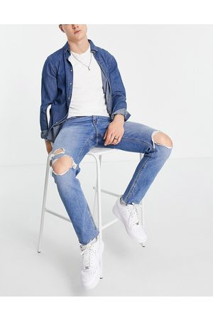 ASOS Slim jeans with knee rips and raw hem in mid wash blue