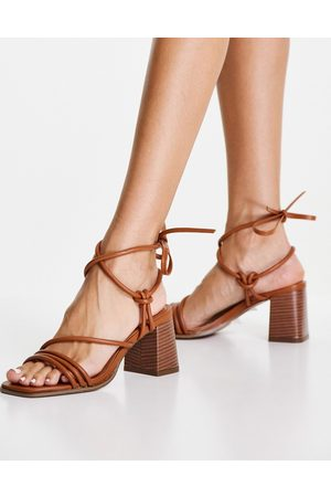 ASOS Hollow strappy tie leg mid heeled sandals in tan-Brown
