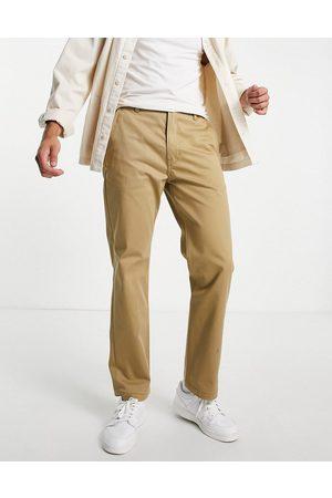 Levi's Levi's Skateboarding regular tapered twill work trousers in harvest gold -Neutral