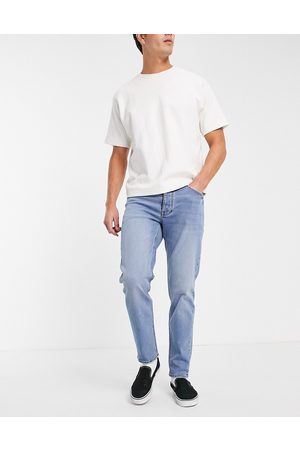 ASOS Herre Tapered - Stretch tapered jeans in mid wash-Blue