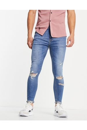 ASOS Herre Skinny - Spray on jeans with power stretch in mid wash with rips-Blue