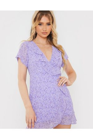 In The Style X Olivia Bowen frill detail wrap mini dress in lilac floral print-Multi