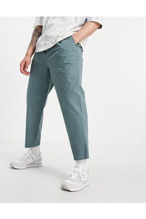 ASOS Wide fit chinos with pleats in blue