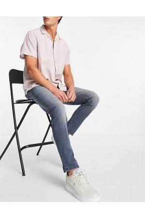 JACK & JONES Intelligence Glenn super stretch slim fit jeans in midwash blue