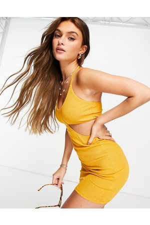 ASOS Cut out ribbed mini dress with tie neck in mustard-Yellow