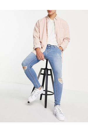 ASOS Spray on jeans with power stretch in light wash with knee rips-Blue